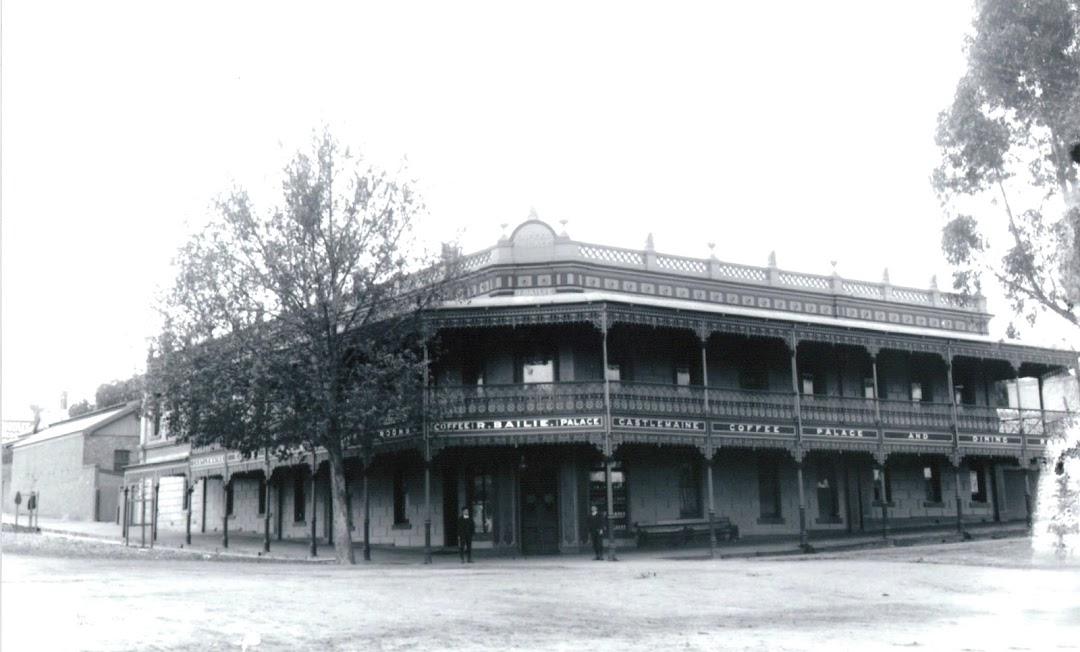 Old black and white photo of The Midland Accommodation Hotel.